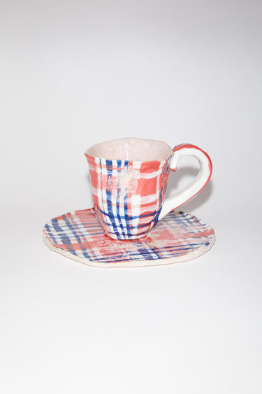 Acne Studios bleach check cup and plate set is a limited edition collaboration with artist Bettunika, made in ceramic with inspiration from the Face collection.