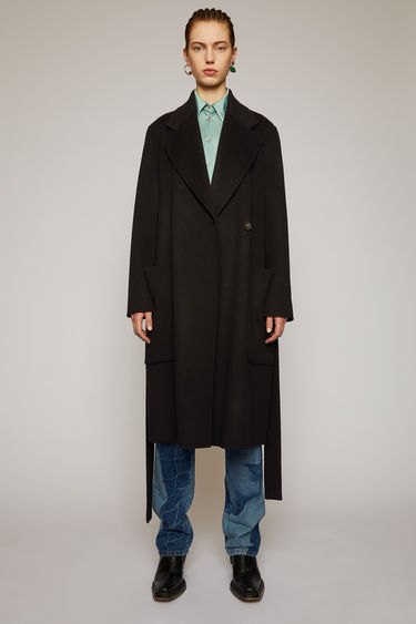 Acne Studios black coat is crafted from double-faced wool to a relaxed fit with wide notch lapels and features a concealed double-breasted button placket and a matching tie belt.