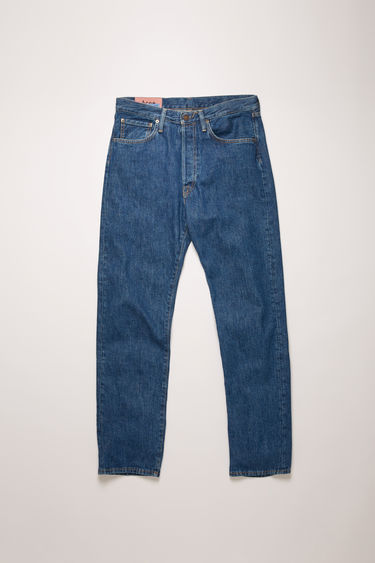 Acne Studios 2003 Dark Blue Trash jeans are crafted from rigid denim that's been stonewashed to give a worn-in appeal. They're cut to sit low on the waist and have a dropped inseam that sets a loose silhouette.