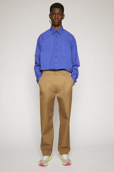 Acne Studios mushroom beige twill trousers are cut a straight-leg fit and finished with wide belt loops and patch pockets.
