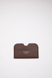 Acne Studios dark brown card holder is made of soft grained leather with a silver logo stamp.