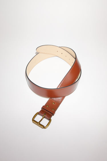 Acne Studios brown belt is crafted to a wide dimension from high-shine leather and features an antiqued gold-tone buckle.