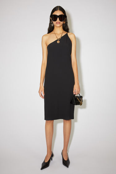 Acne Studios black crepe one-shoulder evening dress has a front slit and straight fit.
