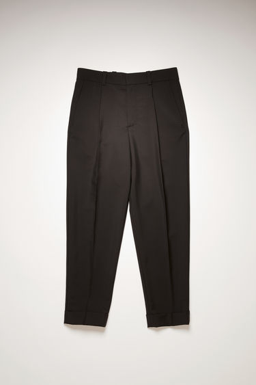 Acne Studios black tapered trousers are made from a wool and mohair-blend and neatly finished with front pleats and cuffed hems.