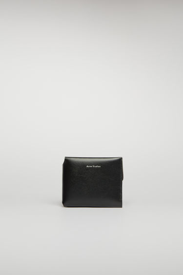 Acne Studios black card wallet unfolds in three ways to reveal an internal coin pocket, four card slots and a slip pocket for notes.