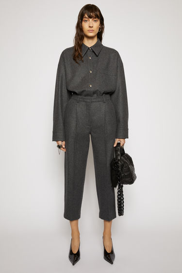 Acne Studios charcoal grey trousers cut with a high waist and cropped, tapered legs, and are pleated along the front for subtle volume.