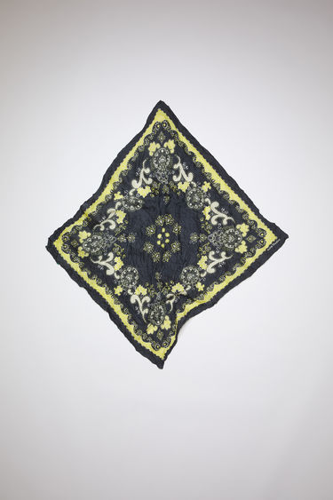 Acne Studios black/yellow crinkled, square-shaped bandana scarf is made of a lightweight cotton/silk blend and features a modified paisley print.