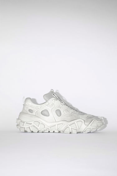 Acne Studios white distressed lace-up sneakers are made of a suede-like fabric.