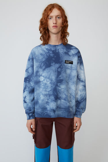 Acne Studios navy/blue sweatshirt is shaped for an oversized fit and features a book title patch and anatomy patch.
