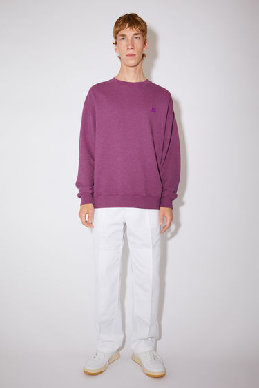 Acne Studios pink oversized sweatshirt is made of organic cotton with a face logo patch and ribbed details.