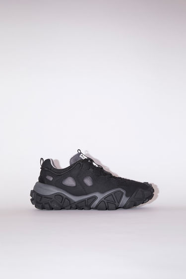 Acne Studios Bolzter W anthracite grey are technical sneakers with heavily textured rubber soles.