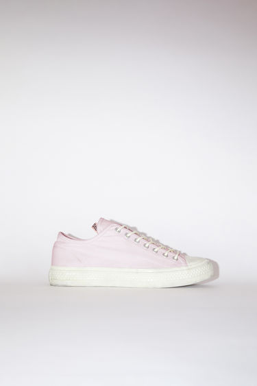 Acne Studios pink/off white distressed canvas lace-up sneakers have rubber toes and soles.