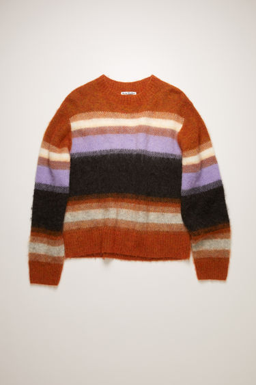 Acne Studios pumpkin orange/multi sweater is knitted from alpaca and wool-blend and features a multicoloured stripe pattern. It's shaped to a relaxed, boxy shape with dropped sleeves, then finished with ribbed edges.