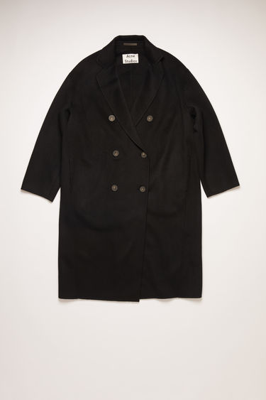 Acne Studios black double-breasted wedge coat with offset shoulder seams and wide sleeves.