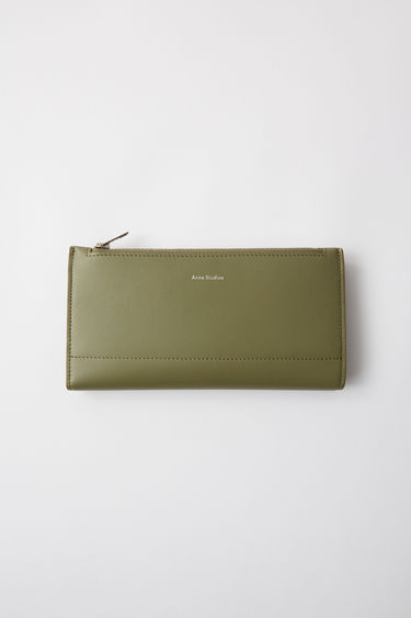Acne Studios dark green continental fold wallet, including zippered pouch and card holders.