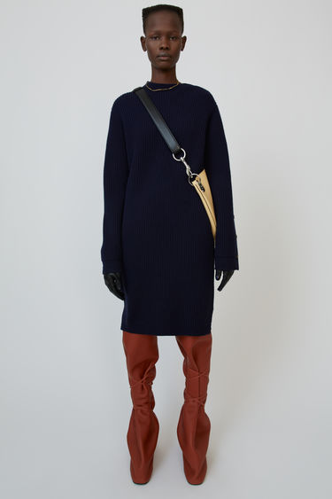 Acne Studios navy blue dress is rib-knitted with wool blend and shaped with round neck and long sleeves.
