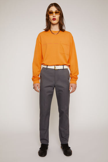 Acne Studios grey cotton-twill trousers are tailored for a slim fit with a straight-leg shape, and have belt loops, slip pockets and two back jet pockets.