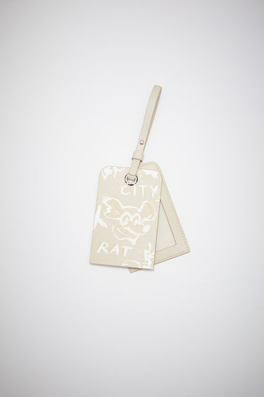 Acne Studios ecru beige luggage tag is made of leather with an all over Welcome to Stockholm bleached print.