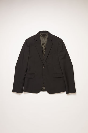 Acne Studios black tailored suit jacket with constructed shoulders.