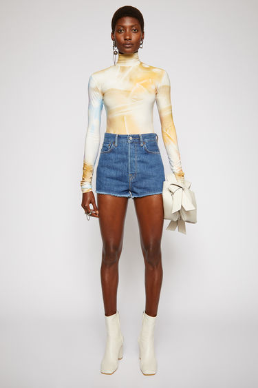 Acne Studios dark blue denim shorts is treated with a stone wash for vintage appeal and shaped to a high-rise silhouette with cropped, wide legs.