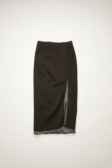 Acne Studios anthracite grey skirt is crafted from boiled wool to a fitted silhouette with a high-rise waist and features satin lining exposed along the hem and the slit at the front.