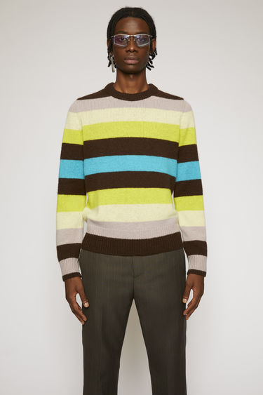 Acne Studios yellow multi sweater is knitted from Shetland wool in a striped pattern, with ribbed crew neck, cuffs and hem.