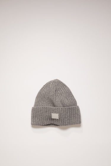 Acne Studios children's grey melange beanie is rib-knitted from soft wool and accented with a tonal face-embroidered patch at the cuff.