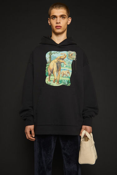 Acne Studios black hooded sweatshirt features a dinosaur print and a patch adorned on front. It's crafted from organically grown cotton to an oversized fit enhanced with dropped shoulders and an exaggerated kangaroo pocket.