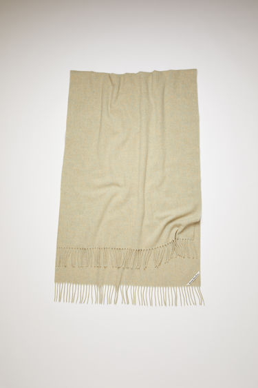 Acne Studios wheat beige oversized fringed scarf is made of pure wool, featuring a label in one corner.