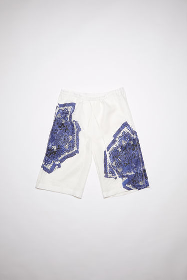 Acne Studios indigo blue linen shorts are cut for a relaxed fit with drawstring waist and two side pockets featuring a scarves print on both legs.