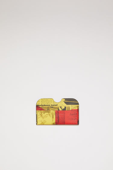 Acne Studios yellow/red card holder is made of soft grained leather with a Stockholm Syndrome newspaper print.