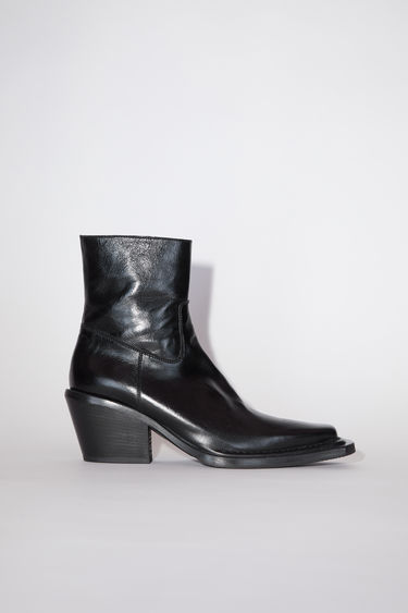 Acne Studios black ankle boots are made of calf leather with zipper closures.