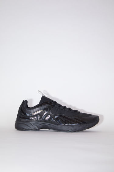 Acne Studios black/black sneakers feature a combination of running and trail elements in one silhouette. They're crafted from semi-transparent ripstop with faux suede overlays and set on a cushioned sole.