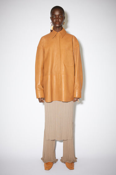 Acne Studios caramel brown leather overshirt is fully lined with a relaxed fit.