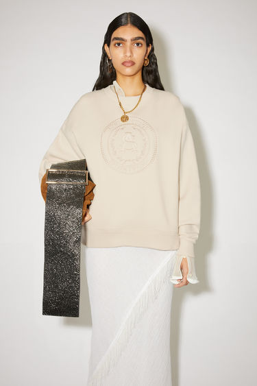 Acne Studios coconut white crew neck sweatshirt is made of cotton with an embroidered design on the front.