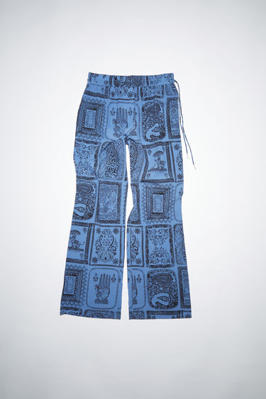 Acne Studios indigo blue casual printed trousers are made of a viscose/silk blend with a relaxed fit.