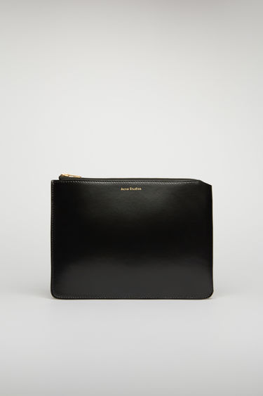 Acne Studios black document holder is crafted from high-shine leather and accented with a gold-tone zip closure and foil branding on the front.
