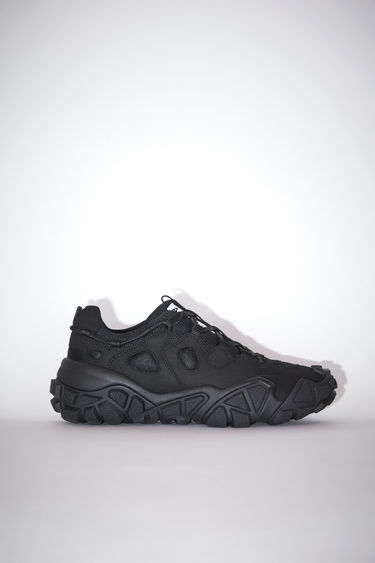 Acne Studios Bolzter M black sneakers are crafted from mesh with faux-suede overlays, and set on chunky tread soles.