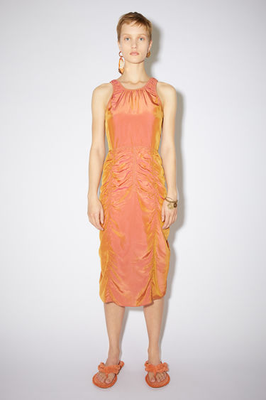 Acne Studios red/orange ruched sleeveless dress is made of iridescent cupro with a fitted silhouette.