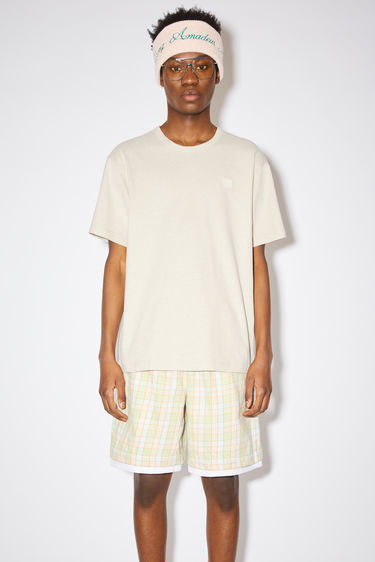 Acne Studios oatmeal melange crew neck t-shirt is made from cotton with a regular fit and a face logo patch.