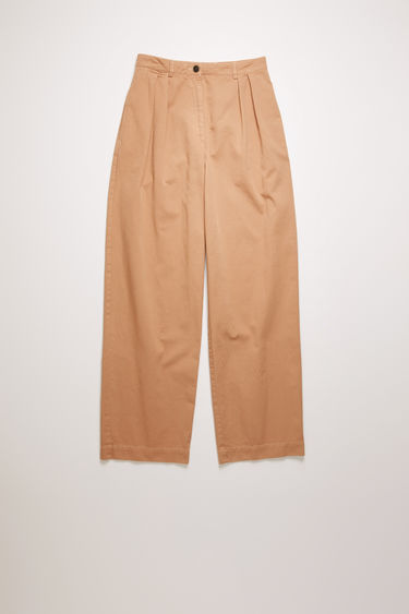 Acne Studios old pink trousers are cut from cotton twill to a relaxed, straight-leg silhouette and finished with a pleated waist band.