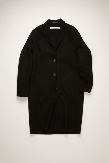 Acne Studios black coat is crafted from double-faced wool to a relaxed silhouette and has notch lapels and three-button closure.