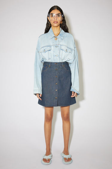 Acne Studios indigo blue skirt is made of rigid cotton denim with a classic, high rise fit.