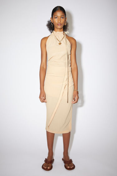 Acne Studios ecru beige draped skirt is made of a viscose/silk blend with a fitted silhouette.
