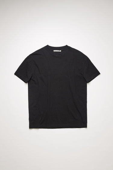 Acne Studios black t-shirt is crafted to a boxy silhouette from slubbed cotton and adorned with a large-scale label patch that's left with loose threads for a subtle note of texture.