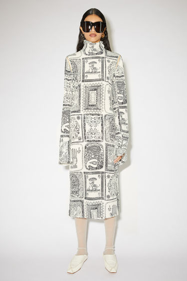 Acne Studios off white high neck dress is made of a printed viscose/silk blend with open shoulder seams.