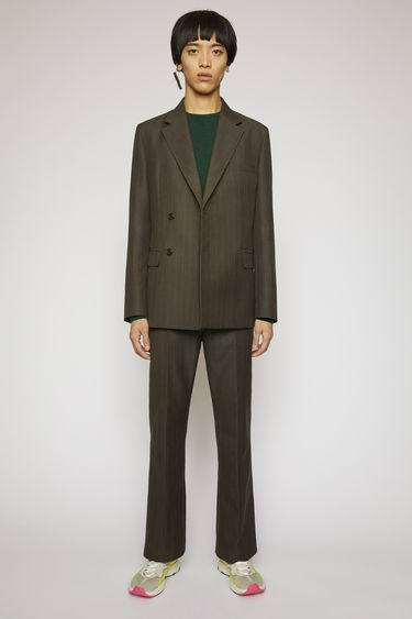 Acne Studios grey/brown suit jacket is crafted from a wool blend with a checked design and features lightly structured shoulders and a concealed double-breasted button closures.