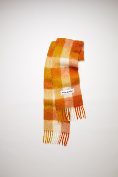 Acne Studios orange/white/ochre large scale check scarf is made of an alpaca blend with fringed ends.