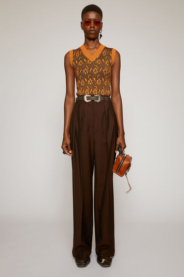 Acne Studios chocolate brown wool-blend trousers are cut to a wide-leg silhouette with a high-rise waist and defined with sharp knife pleats and pressed creases.