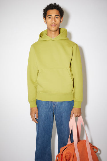 Acne Studios sage green hooded sweatshirt is made from organically grown cotton and recycled polyester that's enzyme-washed for a soft handle and accented with a kangaroo pocket at the front.